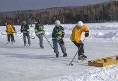 Men`s teams compete in a Pond Hockey Festival in Rangeley. Royalty Free Stock Photos