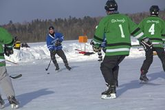 Men`s teams compete in a Pond Hockey Festival in Rangeley. Royalty Free Stock Image