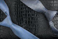 Men's tie lies on the natural leather Royalty Free Stock Photography