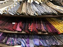 Mens Ties For Sale. Men`s ties sitting on a table display in a mens clothing store. Photo was taken in Gilbert Arizona Stock Image