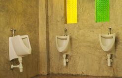 Men`s toilet in coffee shop. Royalty Free Stock Image