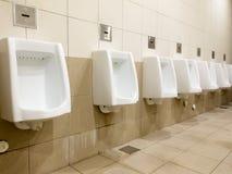 Men's toilet Stock Images