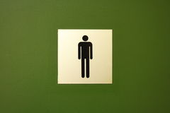 Men's Toilet Symbol. Male toilet symbol on yellow and green background Stock Photo