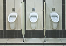 Men's toilet with urinals Stock Photography