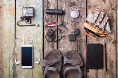 Men's travelling stuff mock up on wood background Royalty Free Stock Photography