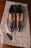 Men's trousers and shoes Stock Photos