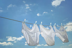 Men's underwear hanging on clothesline. Against blue sky Royalty Free Stock Photography