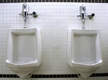 Men's Urinals. Stock Photo