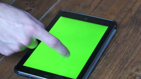 Men`s Using Tablet PC with Green Screen on Wooden Table With Various Hand Gestures. Close Up. Easy for tracking and keying stock video