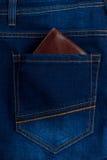 Men's wallet in the back pocket of jeans Stock Images