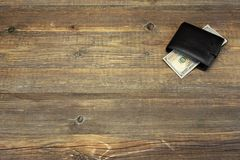 Men's Wallet With Dollar Cash On The Rough Wood Background Stock Photo
