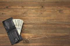 Men's Wallet With Dollar Cash On The Rough Wood Background Stock Image