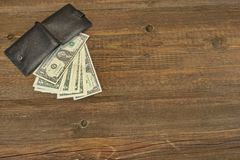 Men's Wallet With Dollar Cash On The Rough Wood Background Royalty Free Stock Photography