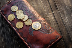 Men`s wallet money in cash wooden white vintage background Royalty Free Stock Photo
