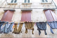 Free Men`s Washed Laundry Hanging On The Facade Of An Old House. Royalty Free Stock Images - 117707219