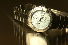 Men's Watch. Men's light blue faced titanium watch on a stainless steel background stock photo