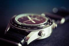 Men`s watch closeup. With selective sharpness in the foreground and with photo effect royalty free stock photography