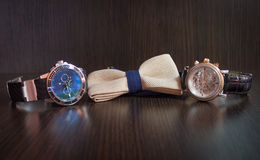 Men`s watch. Men`s tie and watch the edges on the background Stock Photography