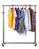 The men's wear hangs on a hanger. Seven multi-coloured shirts hang on a crossbeam Stock Photography