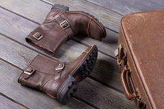 Men's winter boots and a vintage suitcase. Royalty Free Stock Images