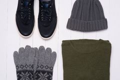 Men`s winter casual outfits with accessories on wooden backgroun. D Royalty Free Stock Photography