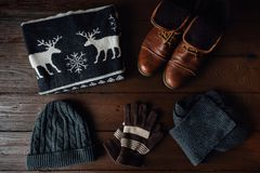 Men`s winter clothes on a brown rustic background Stock Photography
