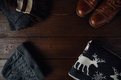 Men`s winter clothes on a brown rustic background. Royalty Free Stock Image
