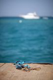 Men's and women's flip-flops on the pier Royalty Free Stock Photos