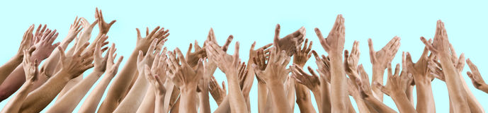 Men's and women's hands raised up royalty free stock photo