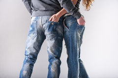 Men's and women's jeans Royalty Free Stock Photography