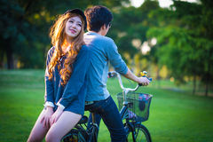 Men 's and women's sunglasses cyclists on the grass surrounded b Stock Photo