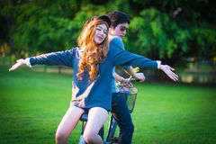 Men 's and women's sunglasses cyclists on the grass surrounded b Stock Image
