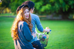 Men 's and women's sunglasses cyclists on the grass surrounded b Royalty Free Stock Image
