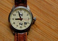 Men´s wrist watch. Men�s wrist watch on wooden background Royalty Free Stock Image