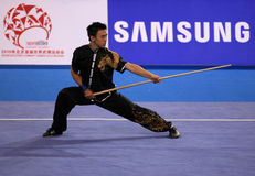Men's Wushu gun shu competition Stock Image