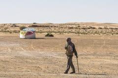 Men on the Sahara. Old man walking on the Sahara desert in Tunisia. Africa Royalty Free Stock Photos