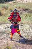 Men in samurai armour with sword. Royalty Free Stock Photos