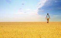 Men in sand desert Stock Images