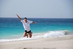 Men on sandy beach - blue ocean. Men on sandy beach, blue ocean, blue sky - holidays on Sal Island, Santa Maria, Cabo Verde Royalty Free Stock Image