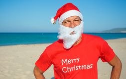 Men in santa hat. Portrait of young man in Santa hat on tropical vacation Royalty Free Stock Photo