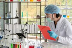 Men scientist researcher is gathering data in lab stock image