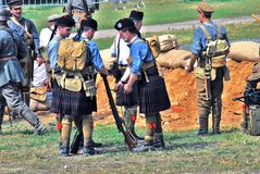 Men in Scottish kilts. MOSCOW - JUNE 08, 2014: Men in Scottish kilts. Historical reenactment of Mincer Nivelle battle held in 1917, the largest battle of the stock photo