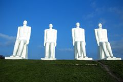 The Men at Sea Monument. ESBJERG - NOVEMBER 9 2017: The Men at Sea is a monument of four 9 meter tall white males, located in Esbjerg, Denmark on the Beach. The Stock Photos