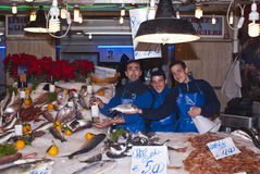 Men selling fish. PALERMO - DECEMBER 22: men selling fish on the local market in Palermo, called Ballaro. This market is also tourist attraction in Palermo Royalty Free Stock Photos