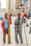 Men selling sugarcane on the street royalty free stock image