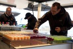 Men serving drinks, Belgium Royalty Free Stock Image