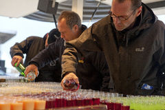 Men serving drinks, Belgium Stock Photos