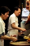 Men Serving Siu Mei in Hong Kong Royalty Free Stock Photo
