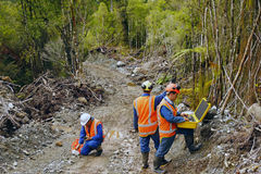 Seismic reflective survey. Men setting off explosive charges in a seismic reflective survey looking for oil on the West Coast of New Zealand Royalty Free Stock Photos