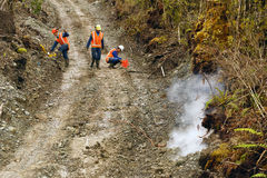 Seismic reflective survey. Men setting off explosive charges in a seismic reflective survey looking for oil on the West Coast of New Zealand Royalty Free Stock Photo